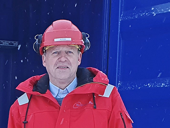 man dressed in red jacket red helmet blue background